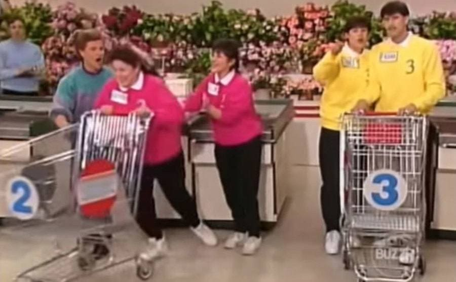 A woman pushing her cart next to the registers starting her team's race