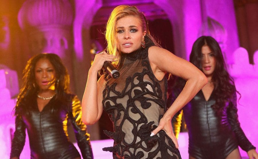 Carmen Electra performing with two backup dancers