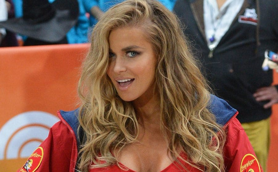 Carmen Electra dressed as her Baywatch character attending an event