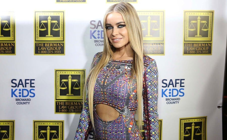 Carmen Electra on the red carpet in a tight colorful dress