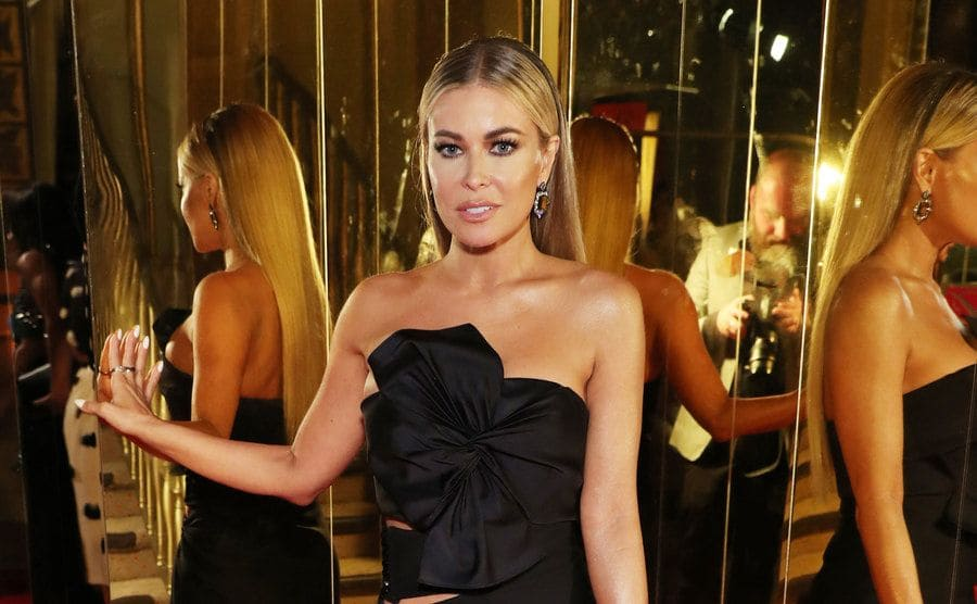 Carmen Electra posing in front of a walls of mirrors