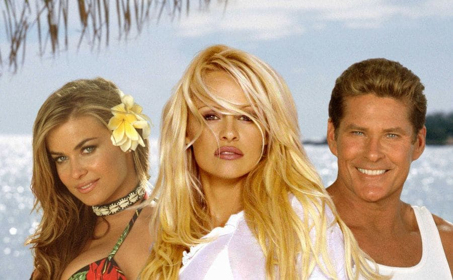 Carmen Electra, Pamela Anderson, and David Hasselhoff posing for a promotional photograph for the newer Baywatch