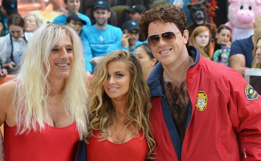 Matt Lauer, Carmen Electra, and Willie Geist dressed as Baywatch characters at an NBC's Today Show event