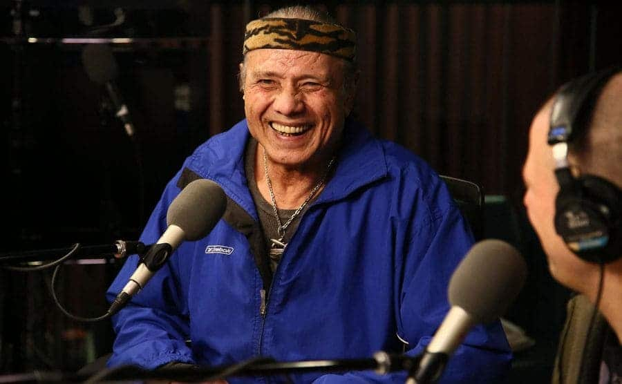 Jimmy Superfly Snuka behind a microphone during a radio interview