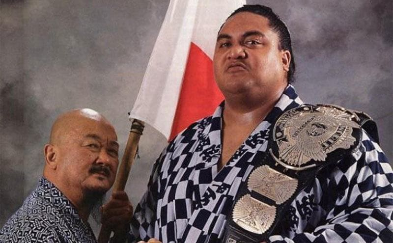 Yokozuna with Mr. Fuji holding a flag and his belt