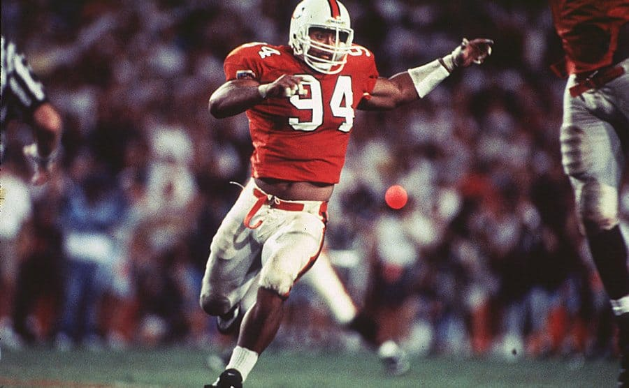 "Dwayne ""The Rock"" Johnson in University of Miami Hurricanes uniform running upfield"