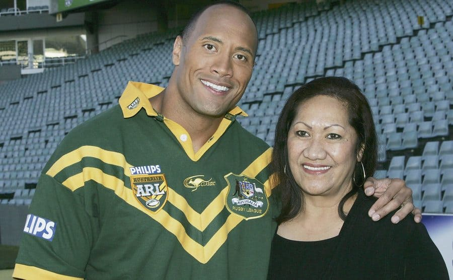 Dwayne Johnson and his mother on a rugby field