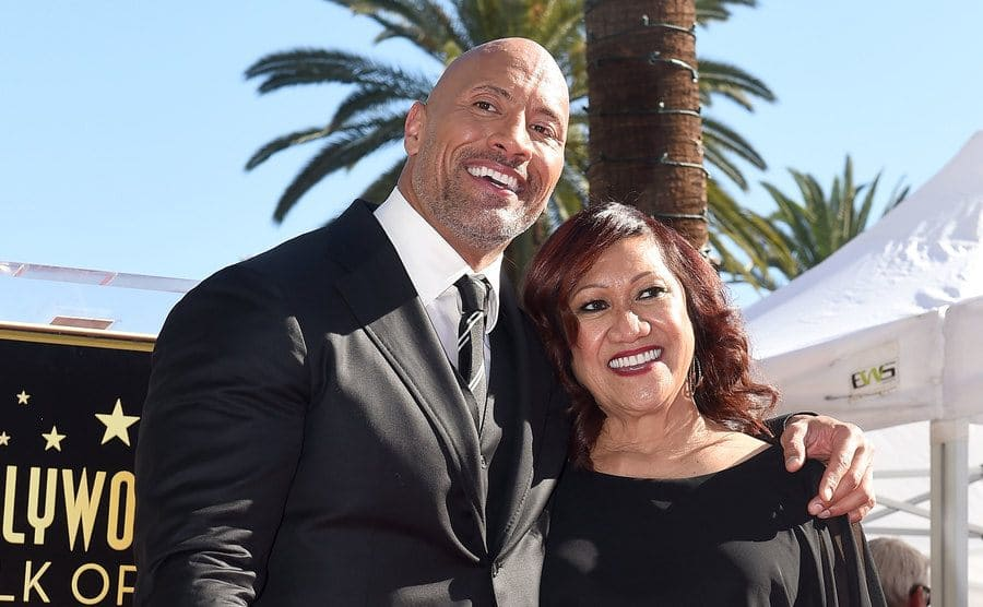 Dwayne Johnson with his mom smiling on the red carpet