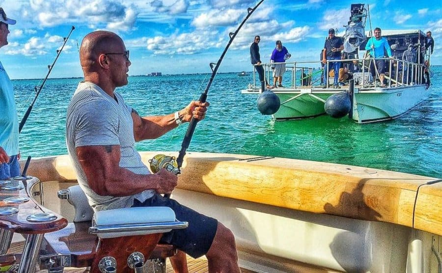 Dwayne Johnson fishing on a boat
