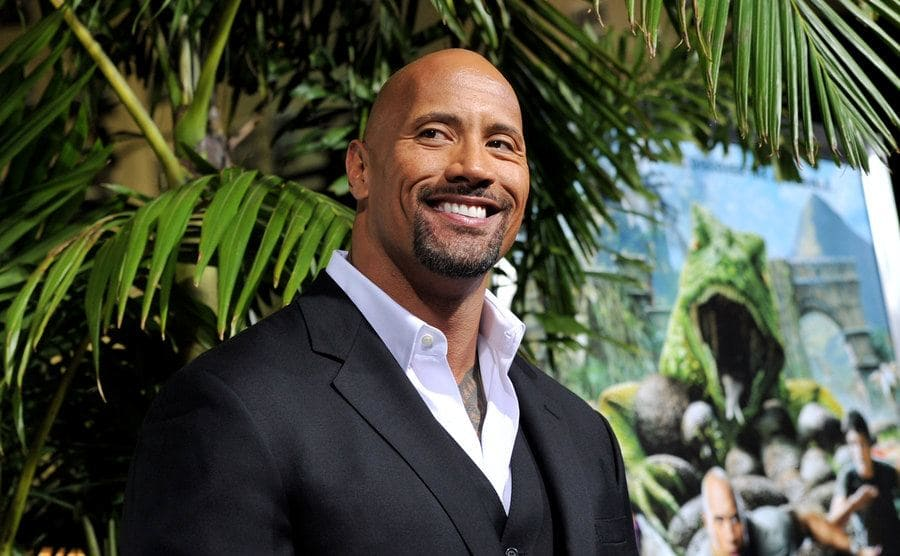 Dwayne Johnson posing at a movie premiere