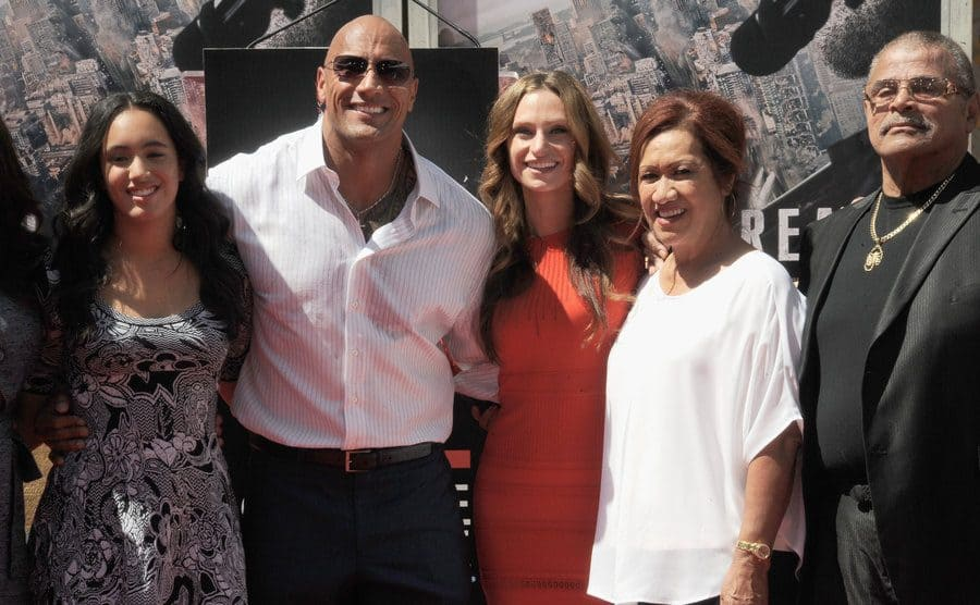Dwayne Johnson with his daughter, wife, and parents