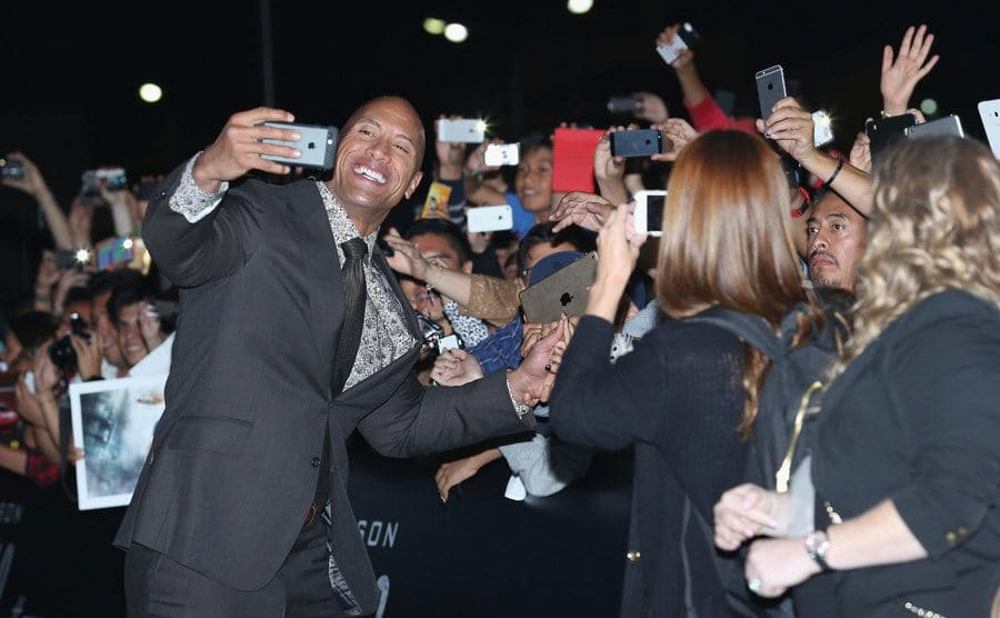 Dwayne Johnson taking a selfie during the San Andreas premiere