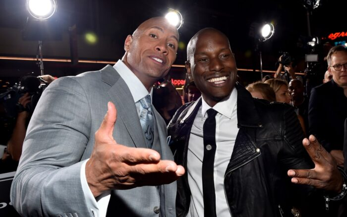 "Actor Dwayne 'The Rock' Johnson (L) and recording artist/actor Tyrese Gibson attend Universal Pictures' ""Furious 7"" premiere at TCL Chinese Theatre on April 1, 2015 in Hollywood, California."