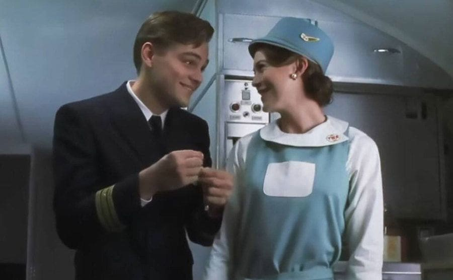 Leonardo DiCaprio talking to Ellen Pompeo in a scene from Catch me if you Can