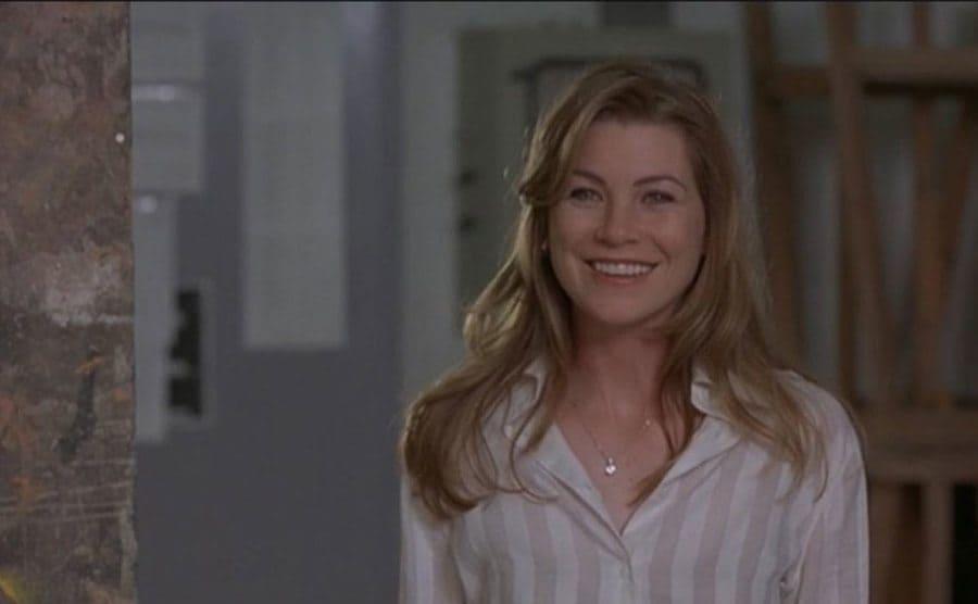 Ellen Pompeo smiling in a scene from Art Heist