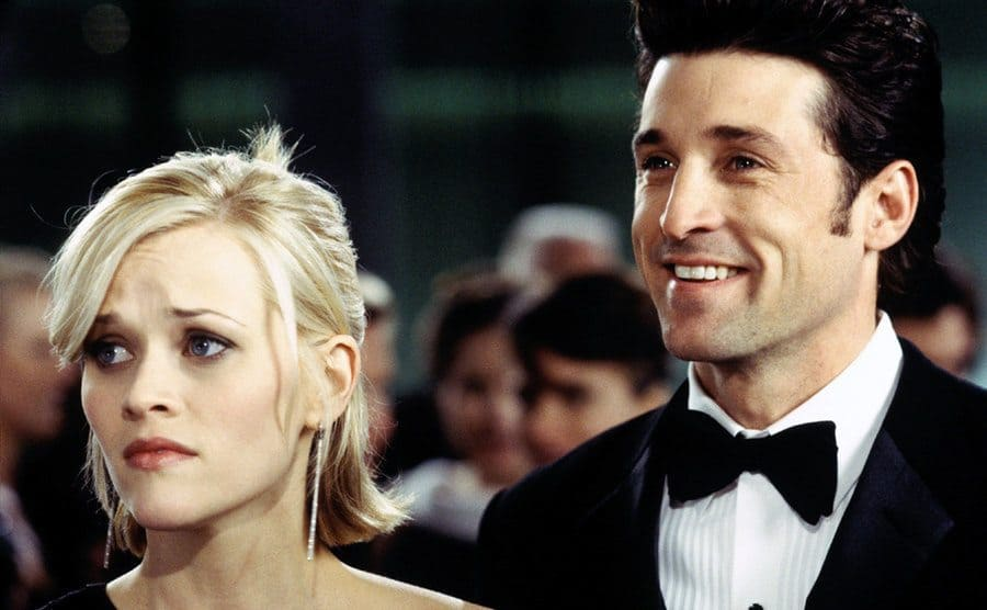 Reese Witherspoon and Patrick Dempsey dressed up for an event in the film Sweet Home Alabama