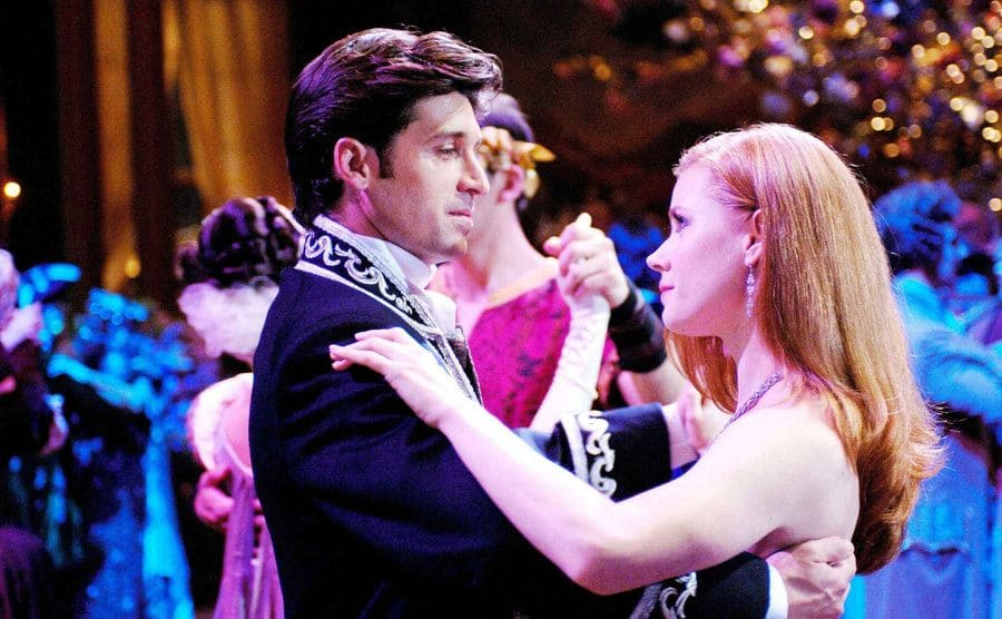 Patrick Dempsey dancing with Amy Adams at a ball in a scene from Enchanted