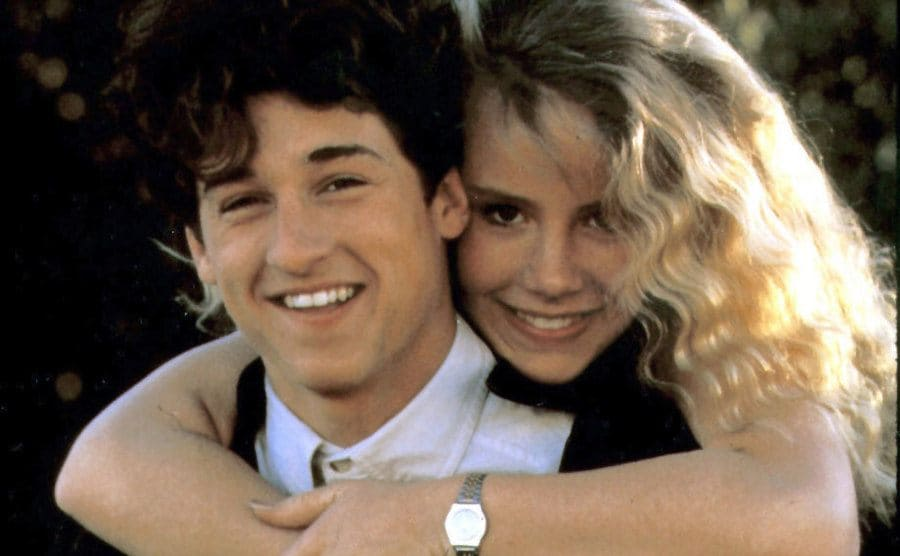 Patrick Dempsey and Amanda Peterson posing for a photograph