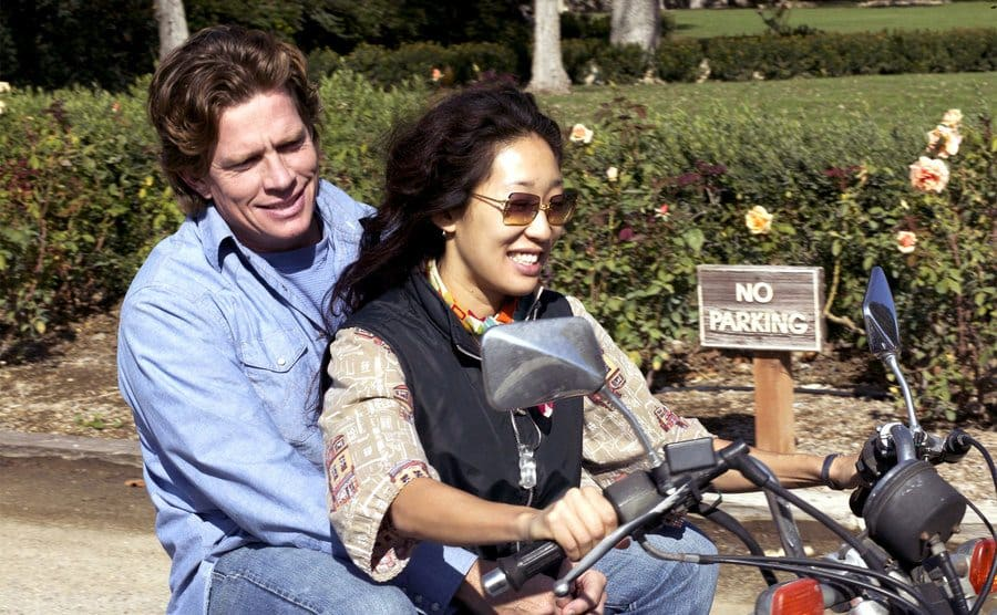Thomas Haden Church riding behind Sandra Oh on a motorcycle in a scene from Sideways