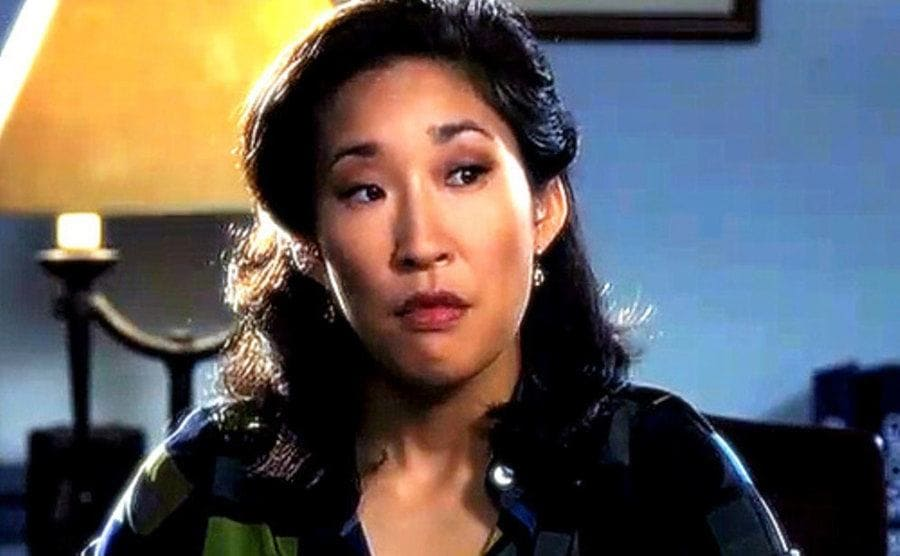 Sandra Oh as the vice principal in The Princess Diaries sititng behind her desk with a stern face