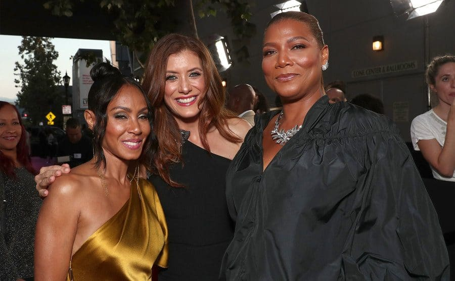 Jada Pinkett Smith, Kate Walsh, and Queen Latifah posing together on the red carpet at the Girls Trip premiere