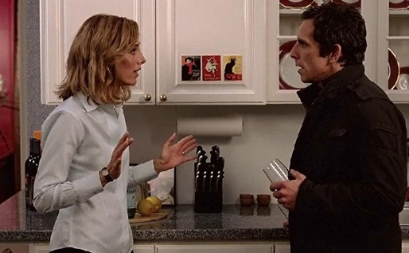 kim Raver and Ben Stiller standing in a fancy kitchen having a discussion