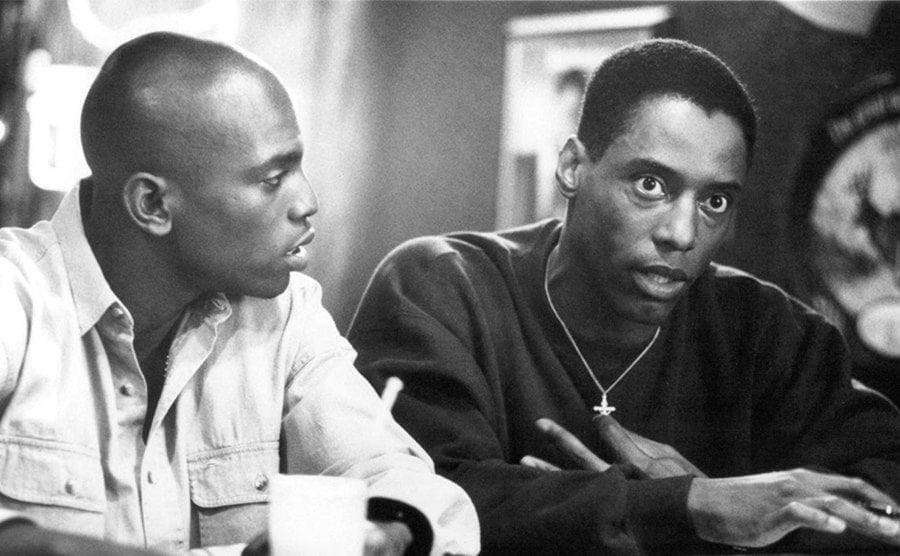 Mekhi Phifer and Isiah Washington sitting at a bar counter in a scene from Clockers