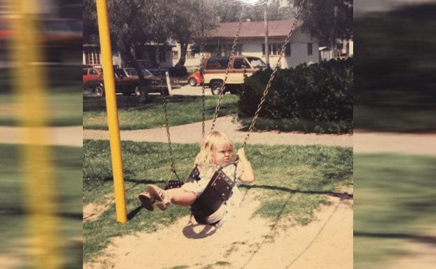 Ronda as a young girl on a swing set
