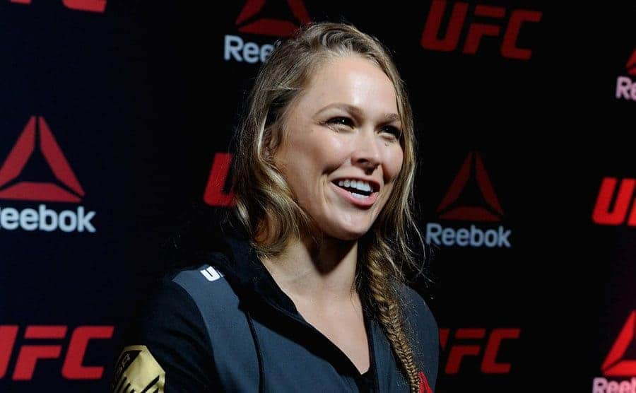 Ronda Rousey with her hair in a fishtail braid and active wear