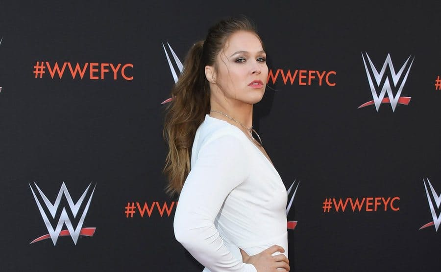 Ronda Rousey on the red carpet in a white dress
