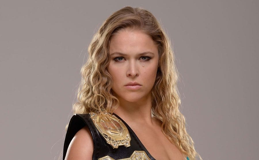 Ronda Rousey poses for a portrait with her Championship belt