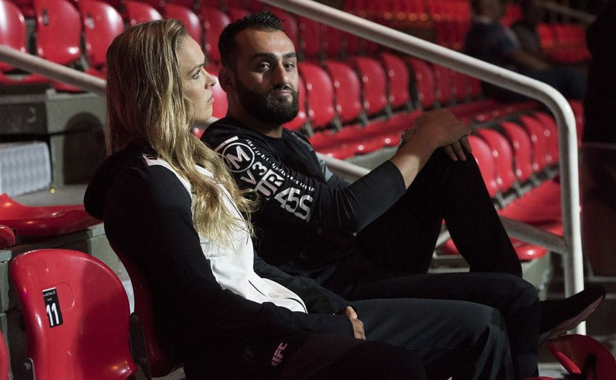Ronda Rousey and her coach sitting in the bleachers