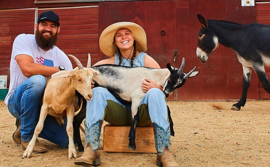 Ronda Rousey and her husband with two goats and a donkey