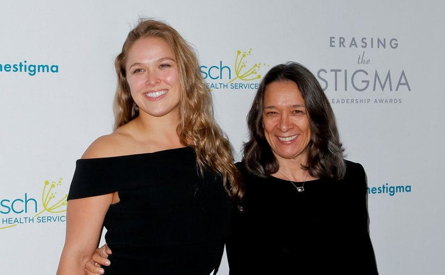 Ronda Rousey and her mother on the red carpet posing
