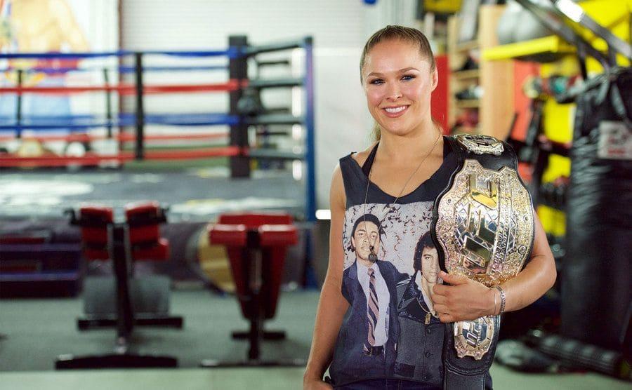 Ronda Rousey holding her UFC championship belt