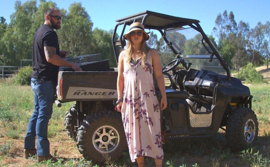Travis and Ronda outside of a Ranger on their ranch
