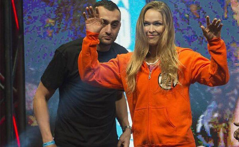 Ronda Rousey arriving in an orange Goku Hoodie