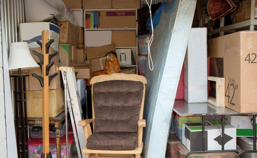 A full storage unit containing household items.