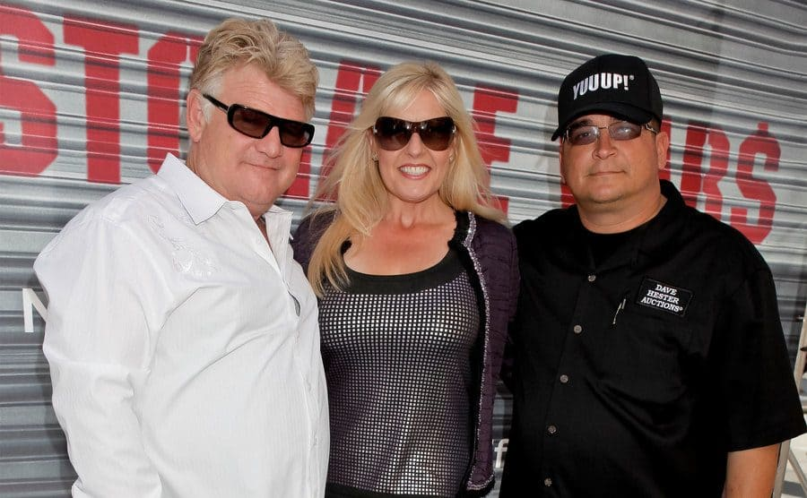 Dan Dotson, Laura Dotson, and Dave Hester pose for photos at A&E's 'Storage Wars' Lockbuster Tour.