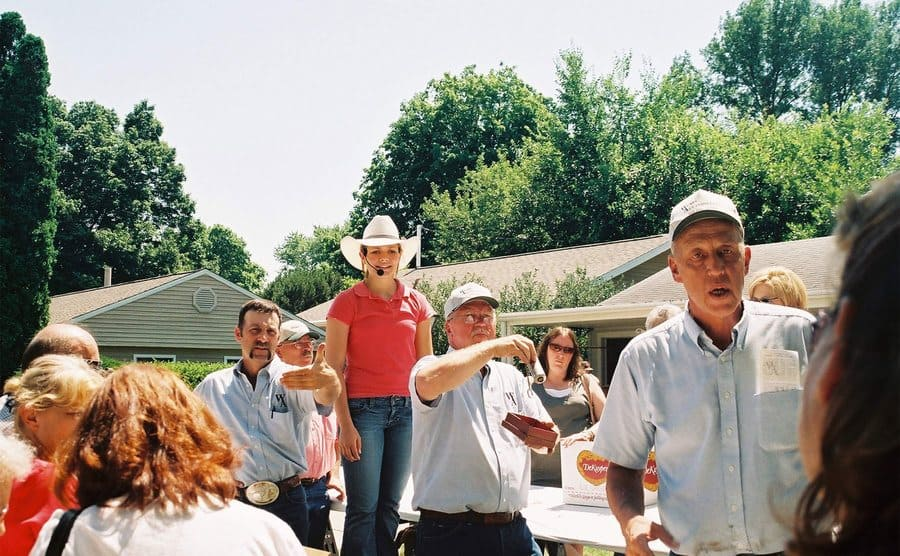 Emily Wears (red polo, center) auctioneers for the first time at a live auction by Wears Auctioneering in 2007.