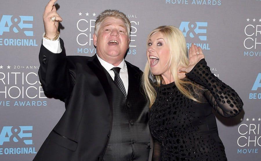 Dan Dotson and Laura Dotson walk down the carpet of the 20th annual Critics' Choice Movie Awards.