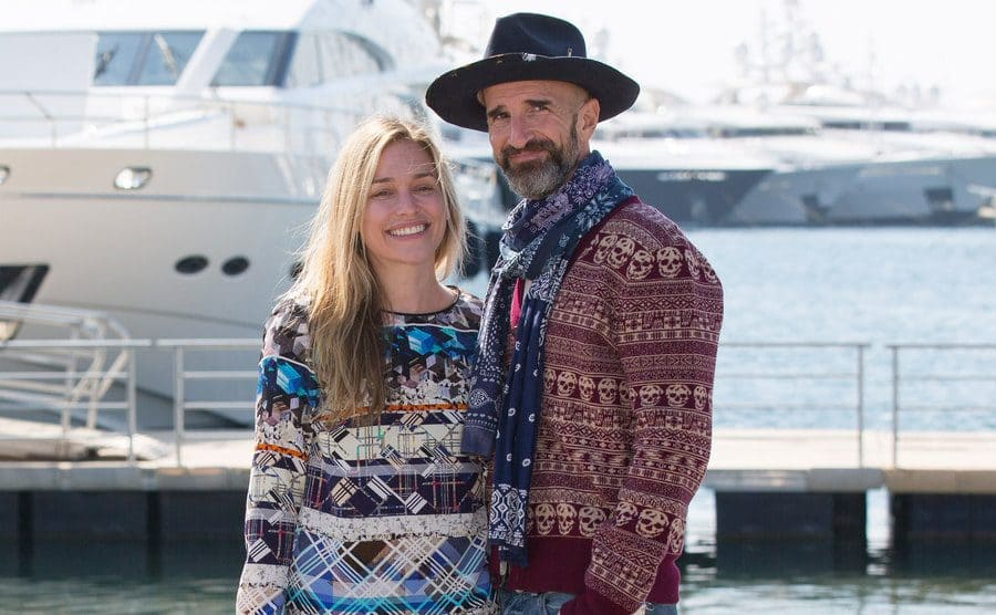 Piper Perabo and Stephan Kay posing together in front of a yacht docked in a port
