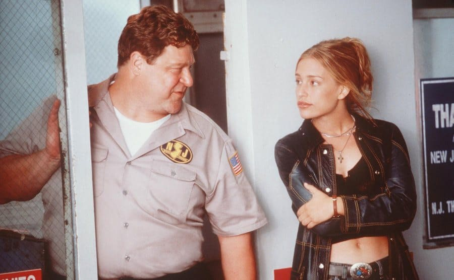 John Goodman and Piper Perabo standing by a half-open door in a scene from Coyote Ugly