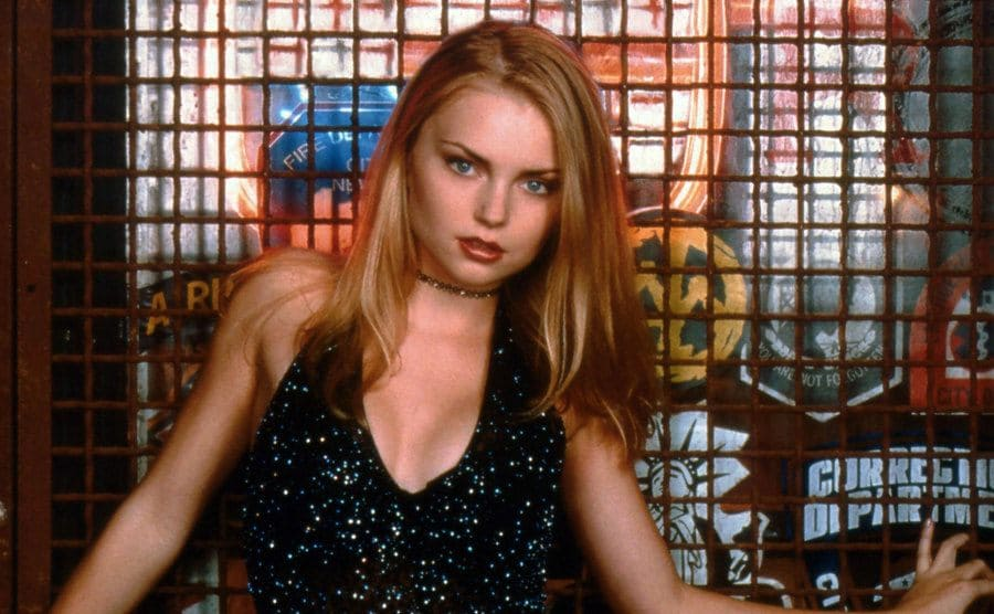 Izabella Miko posing in front of a window with a grate over it for a Coyote Ugly promotional photograph