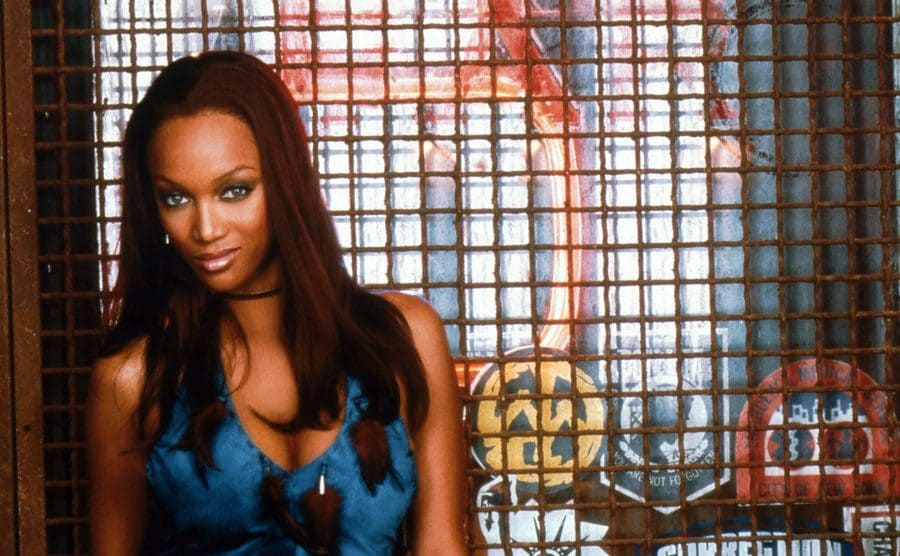 Tyra Banks posing in front of the window grate in a promotional photo for Coyote Ugly