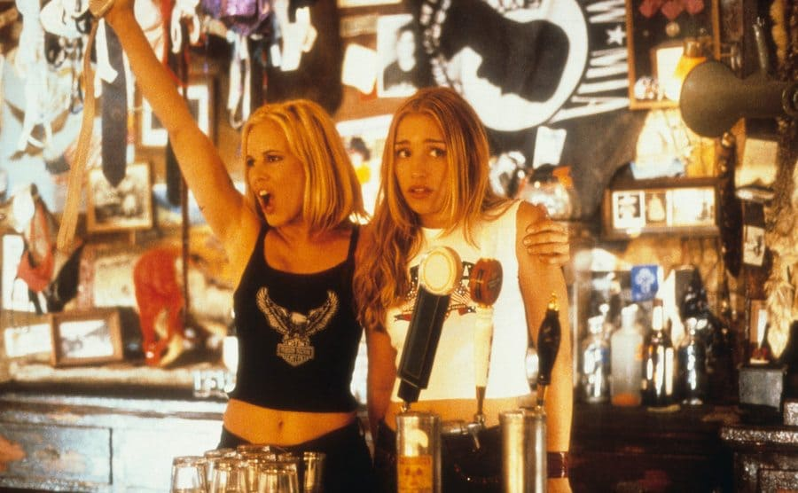 Maria Bello and Piper Perabo behind the bar in a scene from Coyote Ugly