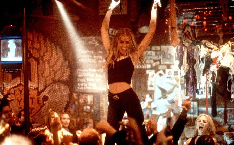 Piper Perabo dancing on the bar in a scene from Coyote Ugly