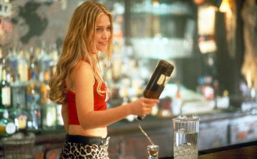 Piper Perabo pouring a shot while flipping the bottle