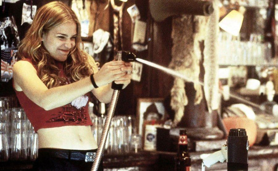 Piper Perabo spraying the bars soda gun over the counter