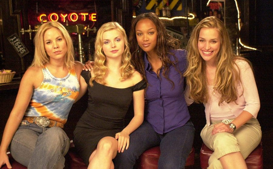 Maria Bello, Izabella Miko, Tyra Banks, and Piper Perabo posing together on the set of Coyote Ugly